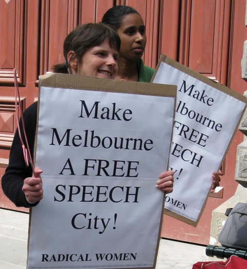 Two women holding signs - Make Melbourne a Free Speech City - Radical Women