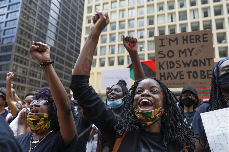 Black women raising fists in protest